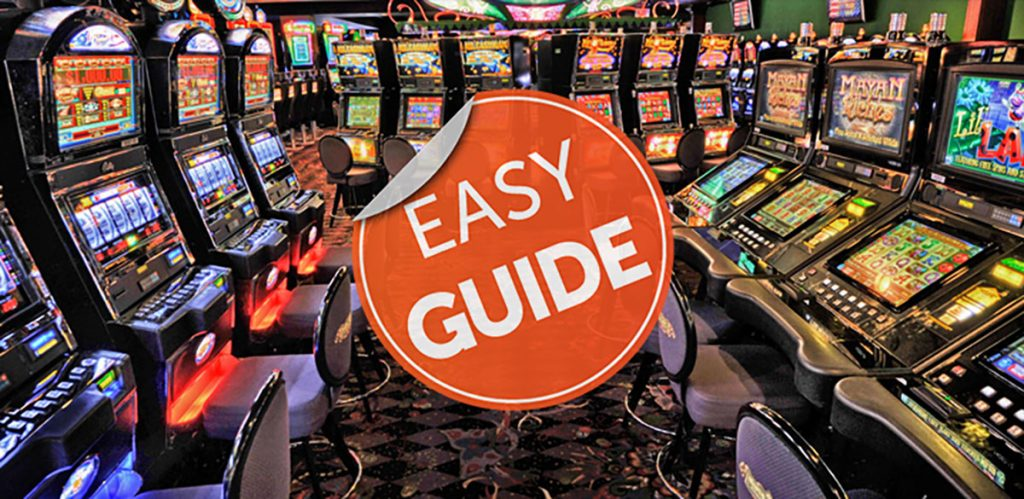 How do you play slot machines at the casino?